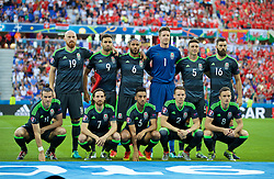 LYON, FRANCE - Wednesday, July 6, 2016: Wales' players line up for a team group photograph before the UEFA Euro 2016 Championship Semi-Final match against Portugal at the Stade de Lyon. Back row L-R: James Collins, Hal Robson-Kanu, captain Ashley Williams, goalkeeper Wayne Hennessey, James Chester, Joe Ledley. Front row L-R: Gareth Bale, Joe Allen, Neil Taylor, Chris Gunter, Andy King. (Pic by David Rawcliffe/Propaganda)