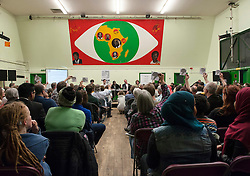 © Licensed to London News Pictures.  20/04/2015. Bristol, UK.  Election Hustings held at the Malcolm X centre in St Pauls with a full hall listening to candidates for Bristol West which could be a marginal seat between the Greens, Labour and the Lib Dems.  Members of the audience were given 'thumbs up' and 'thumbs down' signs to indicate if they liked or disliked what each candidate said.  Candidates from left to right were Thangam Debbonaire (Labour), Darren Hall (Green), chair of the meeting, Stephen Williams (Lib Dem), Claire Hiscott (Conservative).  Photo credit : Simon Chapman/LNP