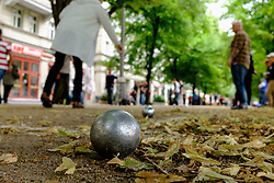 People playing Bocce or boules on Karl Marx Allee in former East Berlin Germany