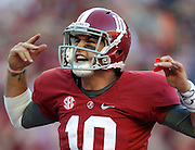 TUSCALOOSA, AL - NOVEMBER 10:  Quarterback AJ McCarron #10 of the Alabama Crimson Tide celebrates after a touchdown during the game against the Texas A&M Aggies at Bryant-Denny Stadium on November 10, 2012 in Tuscaloosa, Alabama.  (Photo by Mike Zarrilli/Getty Images)