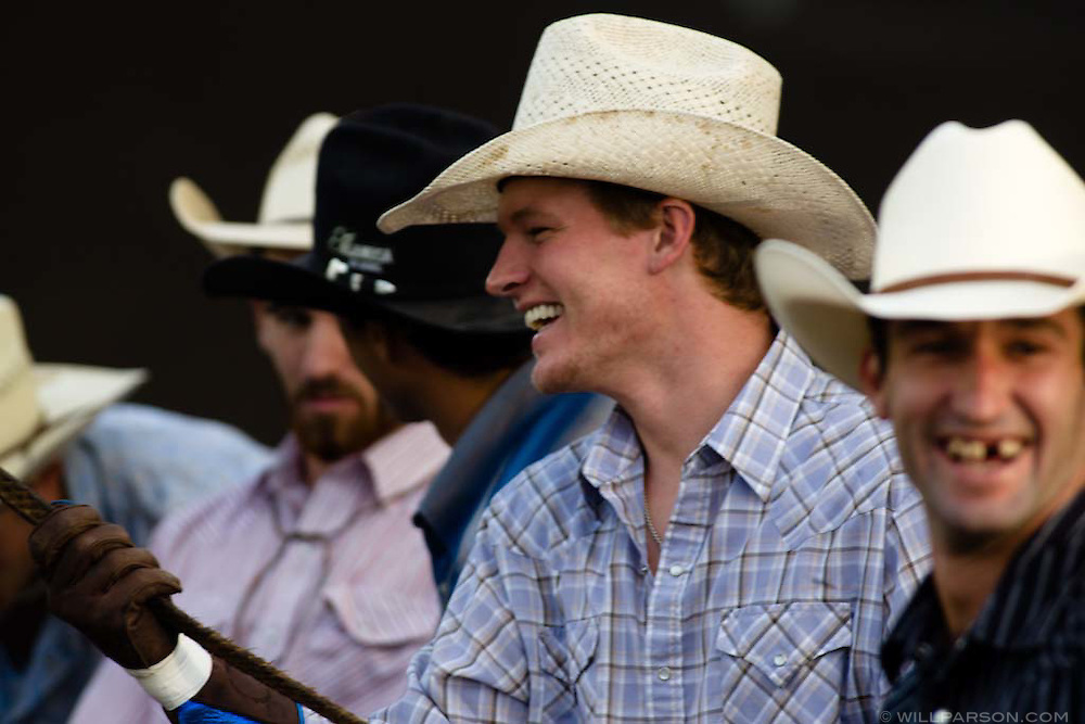 Cole Taylor, 22, from Sayre, OK rosins up his glove while Australian Ben Jones shows a toothy grin before the riding starts during the PBR rodeo at the Del Mar Fairgrounds in Del Mar, California on July 26th, 2008.