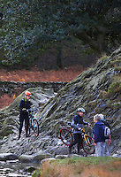 Rydal Water, Cumbria hikers and cyclists on footpath in National Park