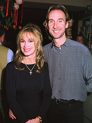 MR & MRS MIKE RUTHERFORD he is a member of the rock group Genesis, at a party in London on 9th December 1997.MEE 27