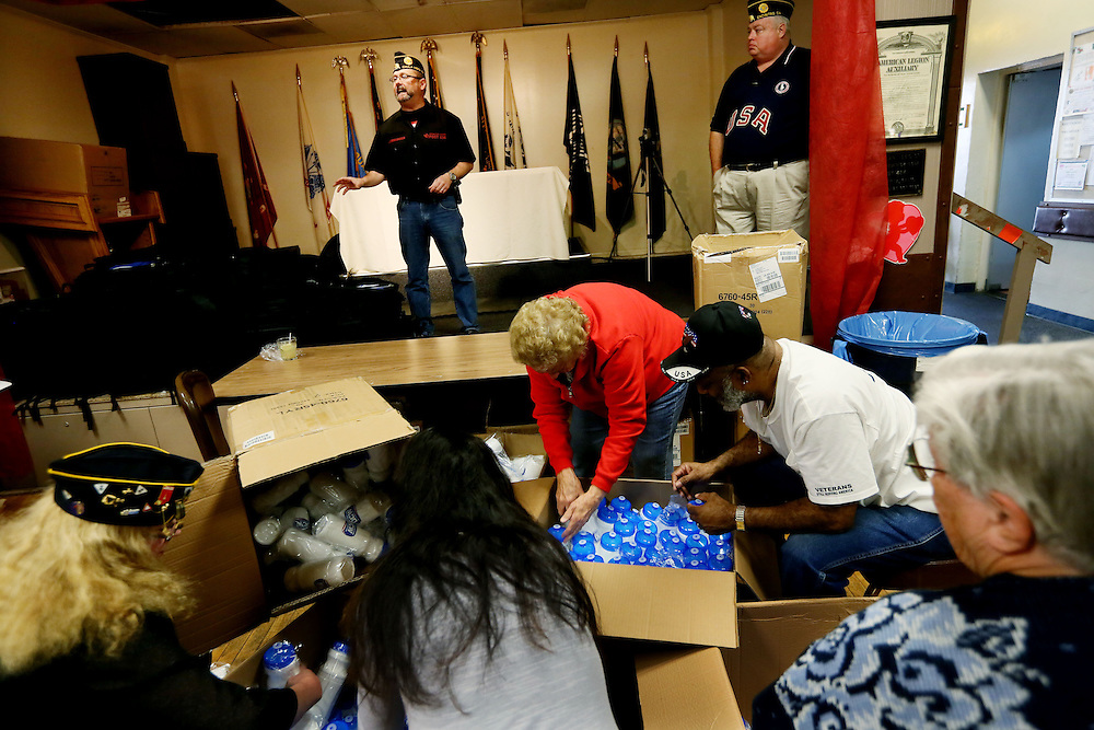Volunteers help stuff items into backpacks at the American Legion Losge 434 in Chula Vista, CA on Friday, February 22, 2013.  The backpacks will be given out next week at a benefit ofr the Wounded Warriors Foundation aboard Camp Pendleton.(Photo by Sandy Huffaker for American Legion)