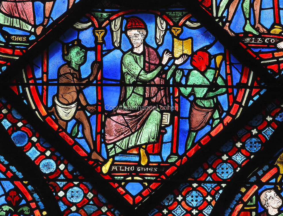 Hermogenes, seated on a throne and holding open his book of magic, calls 2 demons to fetch St James and Philetus. Section of Hermogenes calling the demons to help him, 1210-25, from the Life of St James window in the ambulatory of Chartres Cathedral, Eure-et-Loir, France. This window tells the story of the life of St James the Greater, apostle of Jesus and son of Zebedee. It is situated next to the apostles chapel. Chartres is a stop on the pilgrimage route to Compostela, where James' relics lie. Chartres cathedral was built 1194-1250 and is a fine example of Gothic architecture. Most of its windows date from 1205-40 although a few earlier 12th century examples are also intact. It was declared a UNESCO World Heritage Site in 1979. Picture by Manuel Cohen