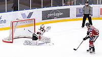 2020-01-11 | Umeå, Sweden:Teg (21) Sebastian Manberg makes the gamewinningshot in  AllEttan during the game  between Teg and Piteå at A3 Arena ( Photo by: Michael Lundström | Swe Press Photo )<br /> <br /> Keywords: Umeå, Hockey, AllEttan, A3 Arena, Teg, Piteå, mltp200111