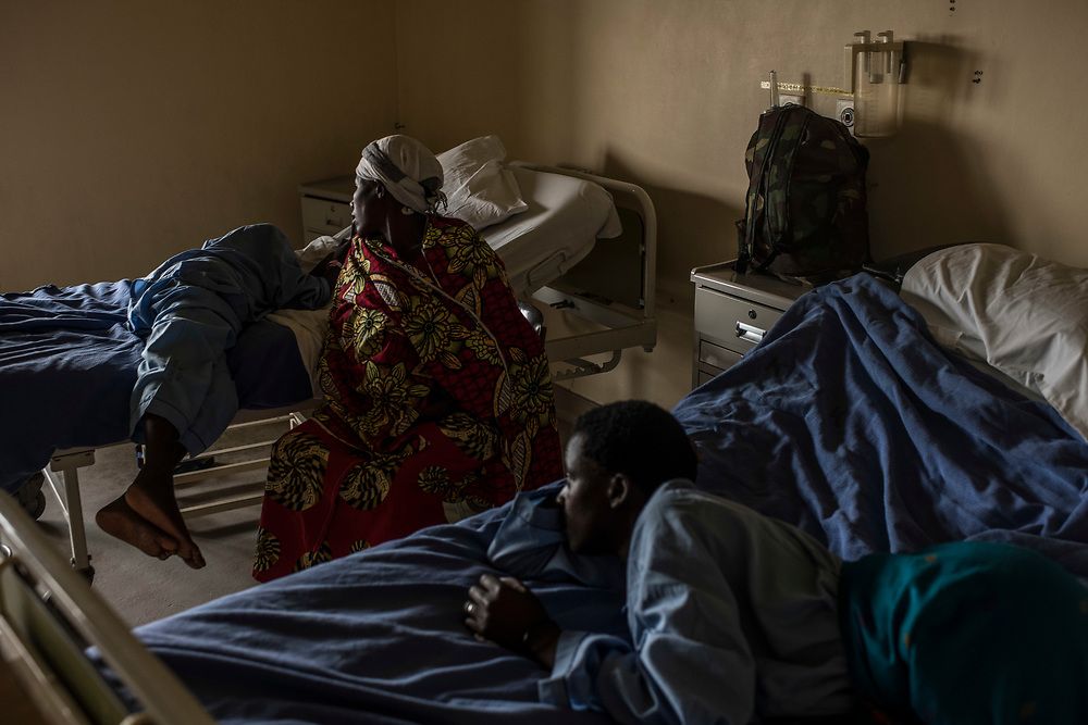 Christine Mukanzayirambaho, 16, her mother, Joseline Nyirandihoreye, and Peninah Nyiracyiza, 36 wait in their beds during the pre-operation period at King Faisal Hospital in Rwanda.<br /> <br /> Rheumatic heart disease is damage to one or more heart valves that stems from inadequately treated strep throat. Left untreated, rheumatic heart disease leads to heart failure.