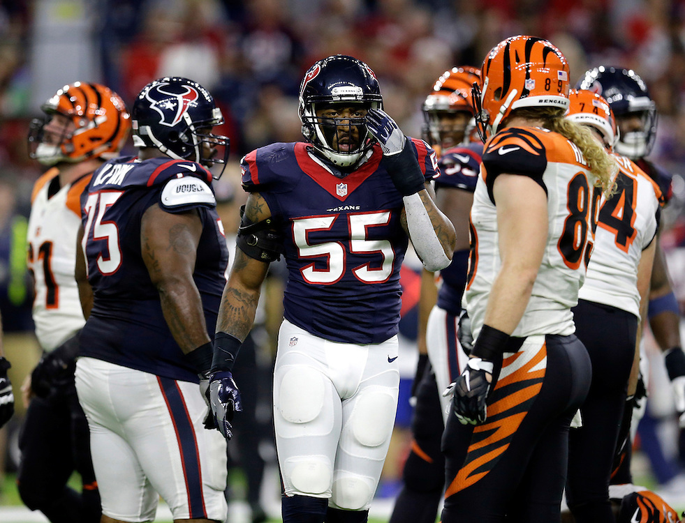 Houston Texans inside linebacker Benardrick McKinney (55) adjusts his helmet against the Cincinnati Bengals during the first half of an NFL football game Saturday, Dec. 24, 2016, in Houston. (AP Photo/Sam Craft)
