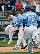 Kansas City Royals' Alex Gordon, left, is lifted up by his teammates after his game-winning hit in the 10th inning of a baseball game against the Chicago White Sox at Kauffman Stadium in Kansas City, Mo., Sunday, May 5, 2013. The Royals beat the White Sox 6-5. (AP Photo/Colin E. Braley)