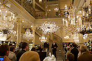 Johannes Rath of Lobmeyr opening a reception at Lobmeyr/Vienna to celebrate the restauration of 11 crystal chandeliers Lobmeyr had created for the foyer and auditorium of New York's Metropolitan Opera, in 1966..The Sputnik-like steel structures with 51.000 individual crystals are completely dismantled, cleaned, and re-built from the ground, while many missing crystals and damaged or outdated parts are being replaced. This takes approximatley one month..Lobmeyr's prestigeuos client list includes H.R.H. Queen Elisabeth II., the Sultan of Brunei, Arnold Schwarzenegger and many others.
