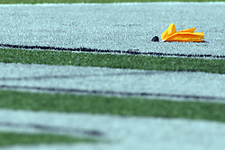 28 September 2013:   Football infraction flag during an NCAA division 3 football game between the Hope College Flying Dutchmen and the Illinois Wesleyan Titans in Tucci Stadium on Wilder Field, Bloomington IL