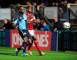 Bristol City's Marlon Harewood and Wycombe Wanderers' Anthony Stewart chase down the ball   - Photo mandatory by-line: Joe Dent/JMP - Tel: Mobile: 07966 386802 08/10/2013 - SPORT - FOOTBALL - London Road Stadium - Peterborough - Peterborough United V Brentford - Johnstone Paint Trophy