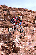 Lars Tribus hucks off a cliff at the 2002 Red Bull Rampage freeride mountain bike competition in VIrgin, Utah.