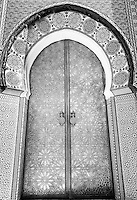 Closed to the public the magnificence of the Dar El Makhzen can only be garnered from the intricate detail and impressive brass doors viewed from Place des Alaouites, Fez, Morocco.