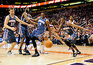 Feb. 4, 2012; Phoenix, AZ, USA; Charlotte Bobcats guard Cory Higgins (11) lounges for the ball as teammate forward Derrick Brown (4) falls over the Phoenix Suns center Robin Lopez (15)  during the second half at the US Airways Center.  The Suns defeated the Bobcats 95 - 89. Mandatory Credit: Jennifer Stewart-US PRESSWIRE.