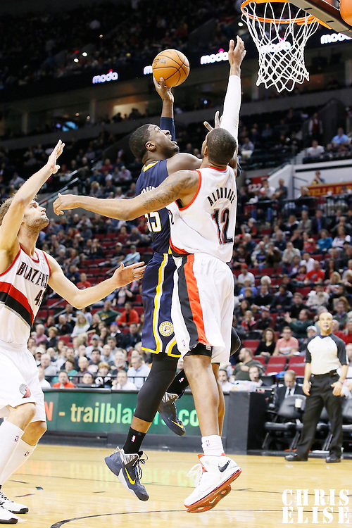 02 December 2013: Indiana Pacers center Roy Hibbert (55) goes for the layup over Portland Trail Blazers power forward LaMarcus Aldridge (12) during the Portland Trail Blazers 106-102 victory over the Indiana Pacers at the Moda Center, Portland, Oregon, USA.