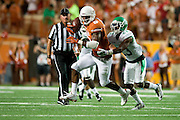 AUSTIN, TX - AUGUST 30:  John Harris #9 of the Texas Longhorns breaks free against the North Texas Mean Green on August 30, 2014 at Darrell K Royal-Texas Memorial Stadium in Austin, Texas.  (Photo by Cooper Neill/Getty Images) *** Local Caption *** John Harris