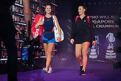 October 26, 2018 - Kallang, SINGAPORE - Kristina Mladenovic of France & Timea Babos of Hungary walk onto the court for their doubles quarterfinal match at the 2018 WTA Finals tennis tournament (Credit Image: © AFP7 via ZUMA Wire)