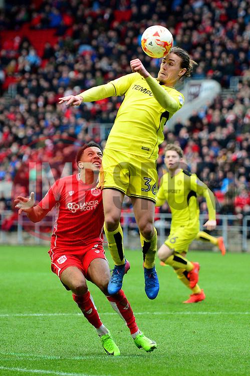 Jackson Irvine of Burton Albion challenges for the header - Mandatory by-line: Dougie Allward/JMP - 04/03/2017 - FOOTBALL - Ashton Gate - Bristol, England - Bristol City v Burton Albion - Sky Bet Championship