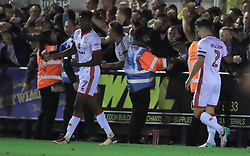 Milton Keynes Dons' Gboly Ariyibi celebrates scoring their second goal of the game