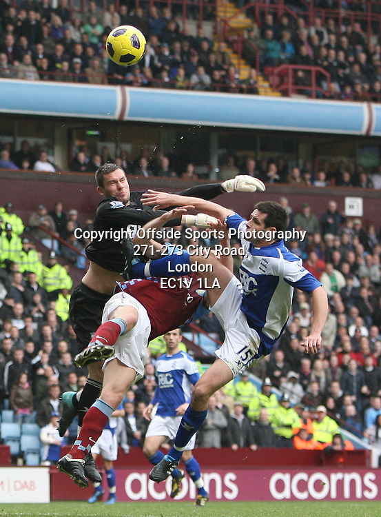 31/10/2010 - Barclays Premier League - Aston Villa vs. Birmingham City - Birmingham goalkeeper Ben Foster collides with teammate Scott Dann of Birmingham - Photo: Simon Stacpoole / Offside.