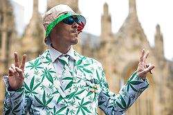 © Licensed to London News Pictures. 23/02/2018. London, UK. A man wears a cannabis leaf suit as campaigners protest opposite Parliament in support of the legalisation of cannabis for medicinal use while MPs debate the issue in The House of Commons. Photo credit: Rob Pinney/LNP
