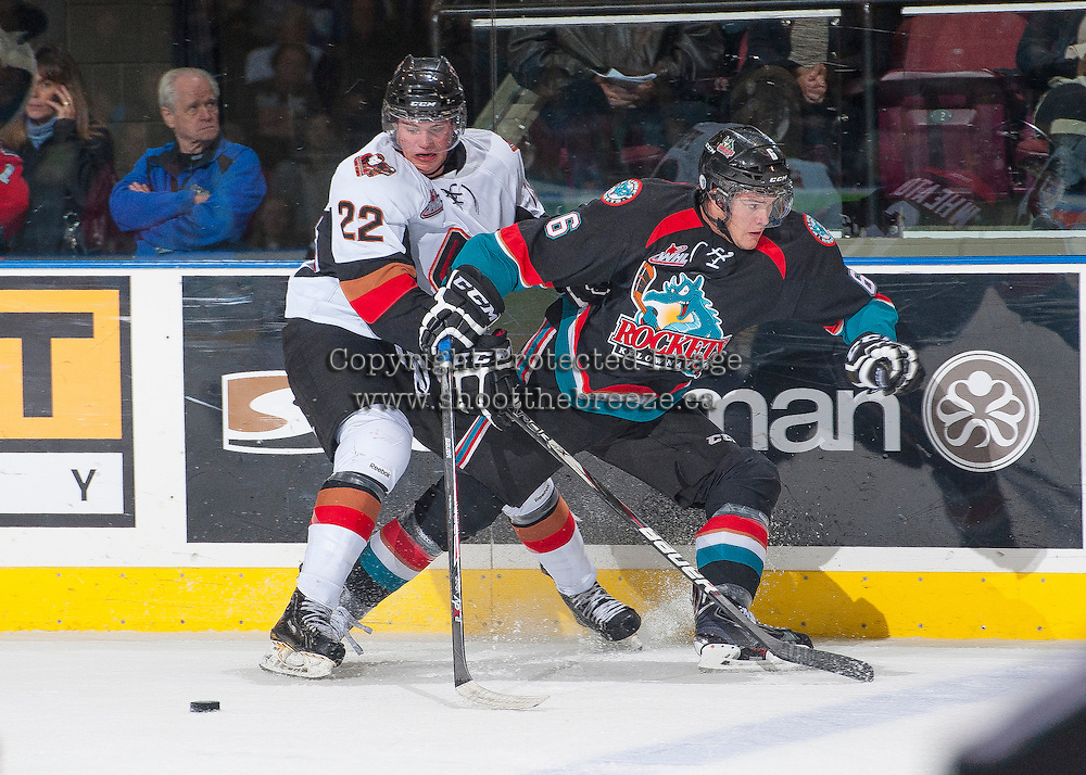 KELOWNA, CANADA - OCTOBER 22: Linden Penner #22 of the Calgary Hitmen is checked at the boards by Mitchell Wheaton #6 of the Kelowna Rockets on October 22, 2013 at Prospera Place in Kelowna, British Columbia, Canada.   (Photo by Marissa Baecker/Shoot the Breeze)  ***  Local Caption  ***