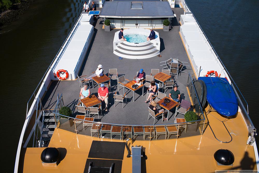 Kluisbergen, Belgium, 1 jun 2017, Tourists on deck of the Avalon Luminary Cruise Ship on the river Scheldt