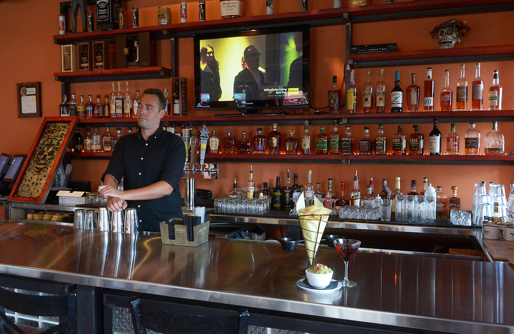 gbs072017e/VENUE -- Bartender Channing Hofman (cq) mixes a drink at the new Zacatecas bourbon bar. .(Greg Sorber/Albuquerque Journal)
