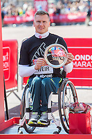 David Weir of Great Britain, runner-up in the Men's wheelchair race on the podium at the Virgin Money London Marathon 2014 at the finish line on Sunday 13 April 2014<br /> Photo: Dillon Bryden/Virgin Money London Marathon<br /> media@london-marathon.co.uk