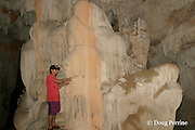 guide points out cave formations at Crystal Cave, on the grounds of Jaguar Paw Jungle Resort, Cayo District, Belize, Central America MR 335