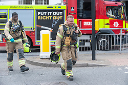 ©Licensed to London News Pictures 16/07/2020     <br /> Bromley, UK. Firefighters on the scene. A large emegency response in Bromley town Centre as two people are taken unwell. A Bromley address has been evacuated due to a suspicious package, Firefighters with breathing apparatus have been seen at the back of an office building. Photo credit: Grant Falvey/LNP