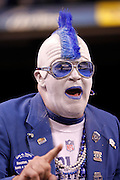 An Indianapolis Colts fan with a painted face and a Halloween costume cheers for his team during the NFL week 8 football game against the Houston Texans on Monday, November 1, 2010 in Indianapolis, Indiana. The Colts won the game 30-17. ©Paul Anthony Spinelli