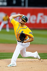 OAKLAND, CA - JUNE 17:  Kendall Graveman #49 of the Oakland Athletics pitches against the Los Angeles Angels of Anaheim during the first inning at the Oakland Coliseum on June 17, 2016 in Oakland, California. (Photo by Jason O. Watson/Getty Images) *** Local Caption *** Kendall Graveman