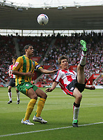 Photo: Lee Earle.<br /> Southampton v West Bromwich Albion. Coca Cola Championship. 12/08/2006. Saint's Grzegorz Rasiak (R) tries an overhead kick, watched by Curtis Davies.