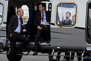 As visitors show interest in the background, delegates rest inside a helicopter on Italian manufacturer's Finmeccanica exibition stand the Farnborough Air Show, England. Finmeccanica is Italy's main industrial group, leader in the high technology sector, and ranks among the top ten defence groups worldwide. It operates in the Aerospace, Defence and Security sectors. Listed on the Milan Stock Exchange (FNC IM; SIFI.MI), the Group recorded revenues of approximately 16 billion Euro in 2013.