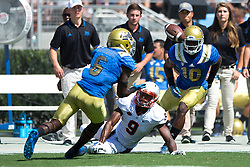 PASADENA, CA - SEPTEMBER 05:  Defensive back Adarius Pickett #6 of the UCLA Bruins intercepts a pass intended for wide receiver Canaan Severin #9 of the Virginia Cavaliers during the third quarter at the Rose Bowl on September 5, 2015 in Pasadena, California. The UCLA Bruins defeated the Virginia Cavaliers 34-16. (Photo by Jason O. Watson/Getty Images) *** Local Caption *** Adarius Pickett; Canaan Severin