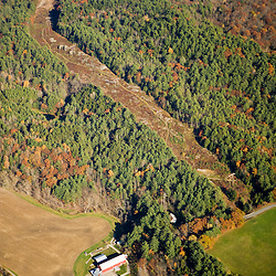A farm and power lines in Monroe, New Hampshire.  Aerial.