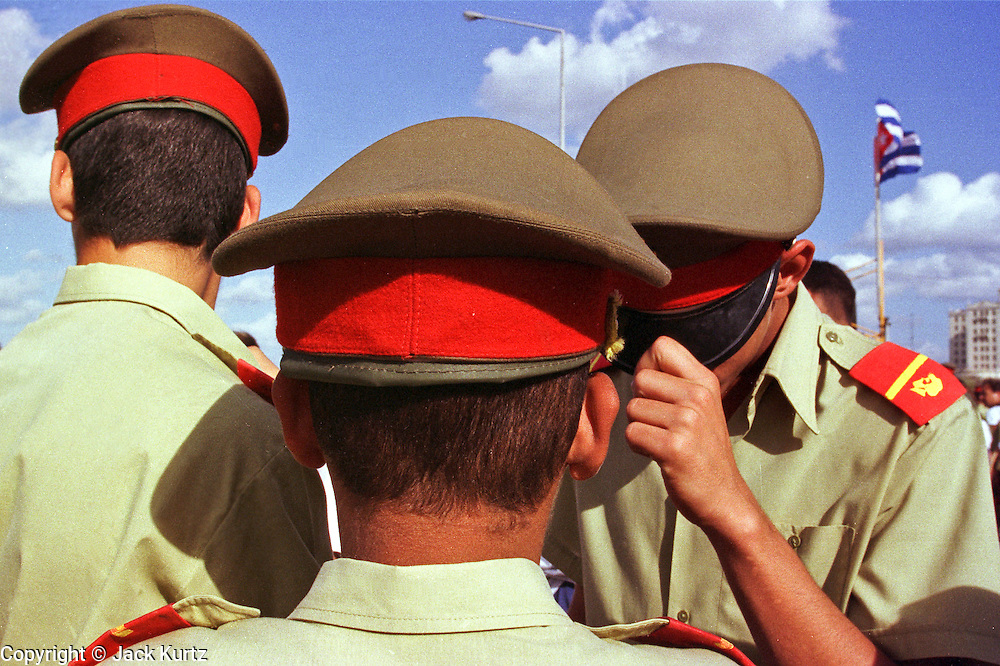 Cuban military cadets wait for an anti-American protest to start in front of the American Interests Section, the US unofficial embassy in Havana, Cuba, February 22. Thousands of Cubans marched in front of the interest section to protest the US unwillingness to return Elian Gonzalez to his father in Cuba.   Photo by Jack Kurtz  CROWDS     HUMAN RIGHTS    YOUTH    EDUCATION    MILITARY   CHILDREN