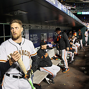 NEW YORK, NEW YORK - APRIL 29:  Hunter Pence #8 of the San Francisco Giants in the dugout preparing to bat during the New York Mets Vs San Francisco Giants MLB regular season game at Citi Field on April 29, 2016 in New York City. (Photo by Tim Clayton/Corbis via Getty Images)