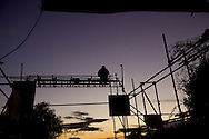 UNITED KINGDOM, Basildon: An ctivist stands on the scaffolding at the entrance to the traveller settlement at Dale Farm in Essex on September 18, 2011 © Christian Minelli.