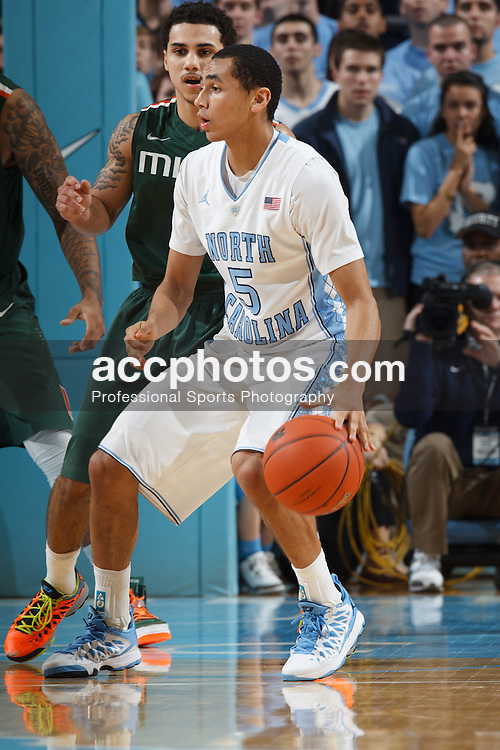 CHAPEL HILL, NC - JANUARY 10: Marcus Paige #5 of the North Carolina Tar Heels dribbles the ball during a game against the Miami Hurricanes on January 10, 2013 at the Dean E. Smith Center in Chapel Hill, North Carolina. Miami won 59-68. (Photo by Peyton Williams/UNC/Getty Images) *** Local Caption *** Marcus Paige