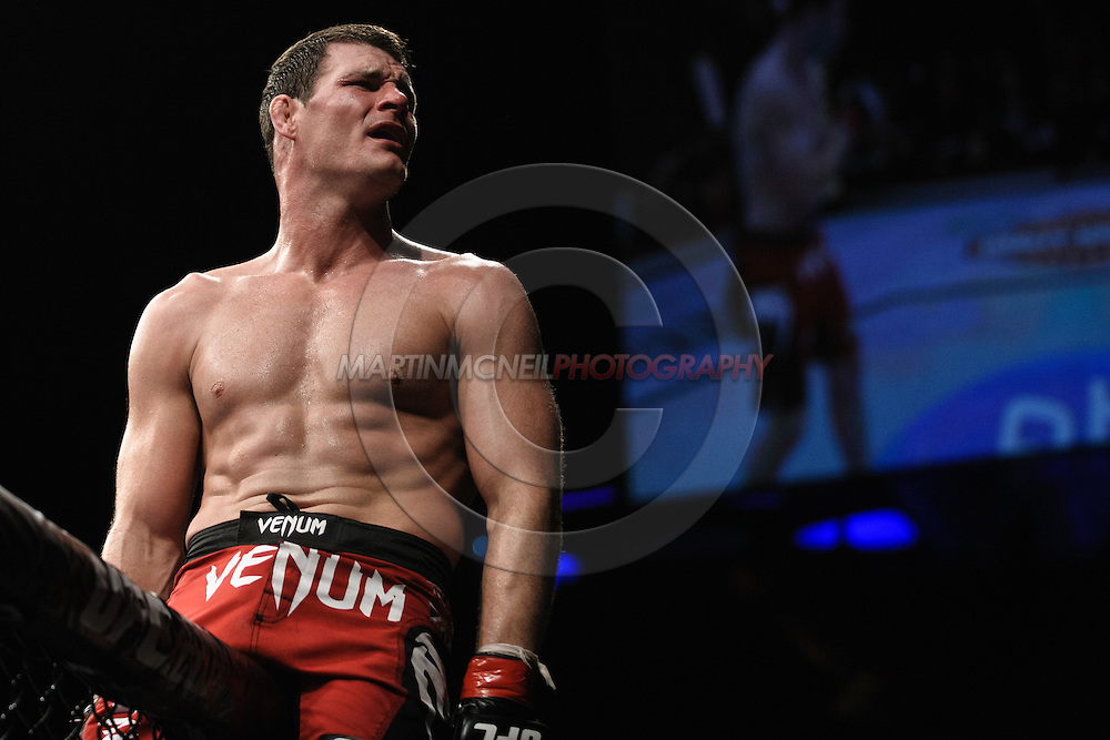 "LONDON, ENGLAND, OCTOBER 2010: Michael Bisping sits atop the cage wall after his fight at ""UFC 120: Bisping vs. Akiyama"" inside the O2 Arena in Greenwich, London"