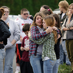 Students and family members reunite at Shoultes Gospel Hall church after an active shooter situation at Marysville-Pilchuck High School in Marysville, Washington October 24, 2014. The shooter who opened fire at a high school in Washington State on Friday was a student at the campus and is now dead following the incident, police said.  REUTERS/Jason Redmond   (UNITED STATES)