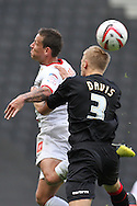 Picture by David Horn/Focus Images Ltd +44 7545 970036.29/09/2012.Charlie Macdonald of Milton Keynes Dons and Harry Davis of Crewe Alexandra during the npower League 1 match at stadium:mk, Milton Keynes.
