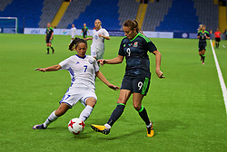 ASTANA, KAZAKHSTAN - Sunday, September 17, 2017: Wales' Kayleigh Green and Kazakhstan's Shokhista Khojasheva during the FIFA Women's World Cup 2019 Qualifying Round Group 1 match between Kazakhstan and Wales at the Astana Arena. (Pic by David Rawcliffe/Propaganda)