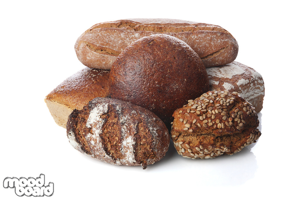 Mix of breads on white background