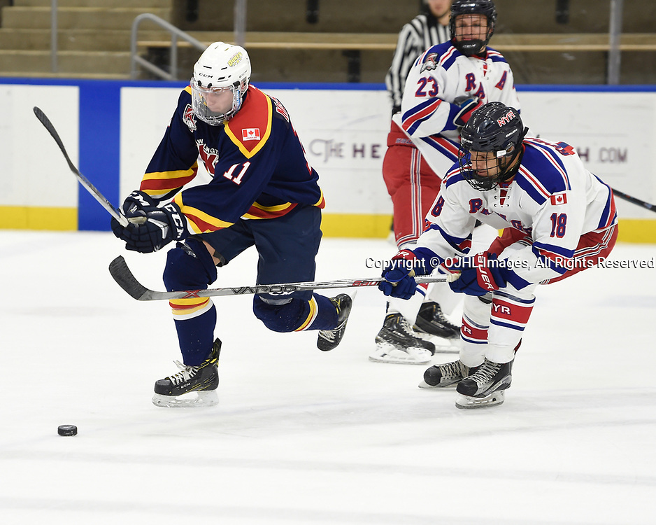 BUFFALO, NY - SEP 19,  2017: Ontario Junior Hockey League Governors Showcase game between the Wellington Dukes and the North York Rangers, Teddy McGeen #11 of the Wellington Dukes battles for the puck with Noah Robinson #18 of the North York Rangers during the first period.<br /> (Photo by Andy Corneau / OJHL Images)