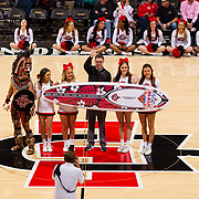 03 February 2018: The San Diego State Aztecs look to rebound after a couple losses against Air Force Saturday night.  San Diego State Aztecs athletic director John David Wicker is presented a surfboard by the cheerleaders showing off their acceptance to the Maui Invitational next fall. The Aztecs lead the Falcons 35-21 at halftime at Viejas Arena. <br /> More game action at www.sdsuaztecphotos.com