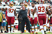 Dec 16, 2018; Jacksonville, FL, USA; Washington Redskins defensive line coach Jim Tomsula celebrates a defensive stop during an NFL game at TIAA Bank Field against the Jacksonville Jaguars. The Redskins beat the Jaguars 16-13. (Steve Jacobson/Image of Sport)